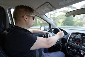 oskar driving the car
